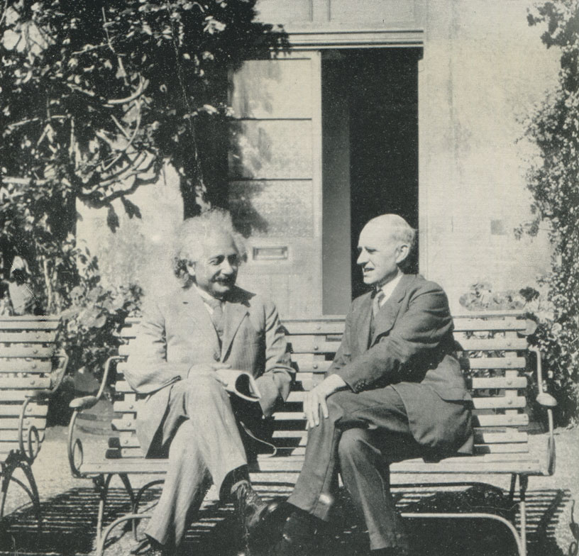Einstein came back to England several times in the early 1930s. In this shot, taken in June 1930, he is in conversation with Eddington in the garden of the Observatory at Cambridge. From a photo attributed to Winifred Eddington